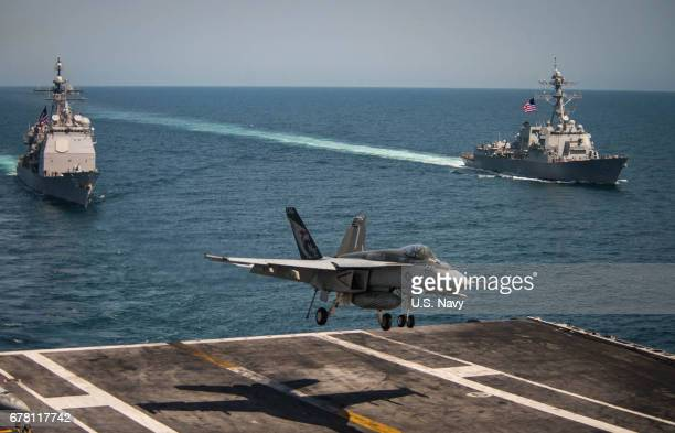 In this handout provided by the US Navy an F/A18E Super Hornet from the Kestrels of Strike Fighter Squadron 137 lands on the flight deck of the...