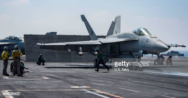 In this handout provided by the US Navy an F/A18E Super Hornet attached to the 'Tomcatters' of Strike Fighter Squadron 31 prepares to launch from the...