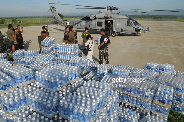 In this handout provided by the US Navy bottles of water transported from the Nimitzclass aircraft carrier USS Ronald Reagan wait to be delivered to...