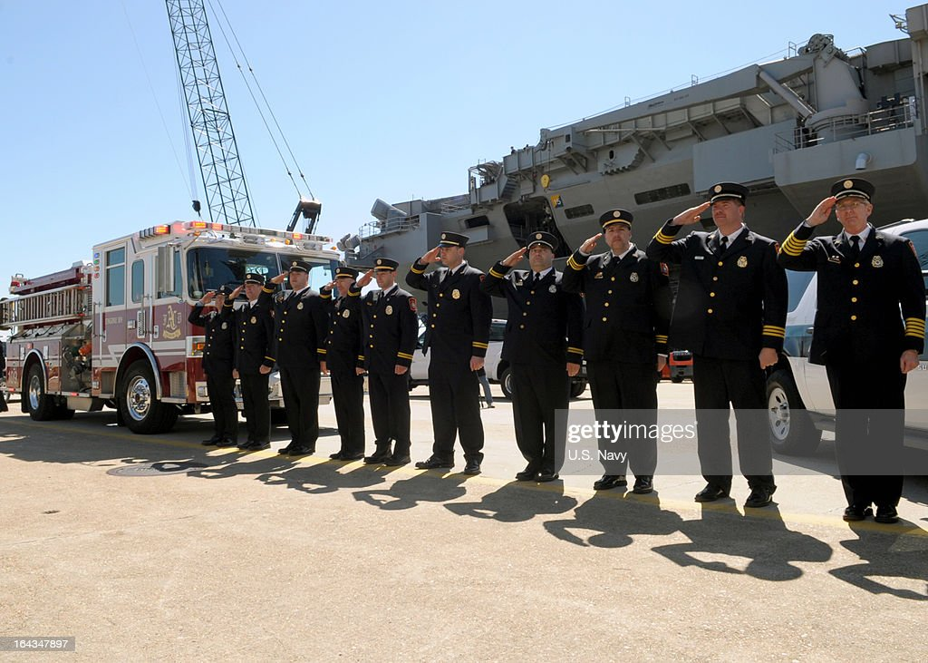 In this handout provided by the U.S. Navy First responders from Arlington County, Va., and the Pentagon salute on March 22, 2013 as the amphibious transport dock Pre-Commissioning Unit (PCU) Arlington (LPD 24) arrives to its homeport at Naval Station Norfolk, Virginia. Arlington is the eighth San Antonio-class amphibious transport dock and the third U.S. Navy ship named for Arlington County, Va., witse American Airlines Flight 77 crashed into the Pentagon on Sept. 11, killing nearly 200 people.