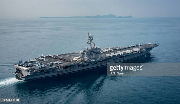 In this handout provided by the US Navy the aircraft carrier USS Carl Vinson transits the Sunda Strait on April 14 2017 in Indonesia The Carl Vinson...