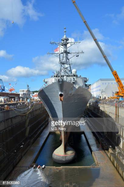 In this handout provided by the US Navy The Arleigh Burkeclass guidedmissile destroyer USS Fitzgerald sits in Dry Dock 4 at Fleet Activities Yokosuka...