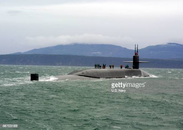 In this handout provided by the US Navy the guided missile submarine USS Ohio stops for a personnel boat transfer January 29 2006 off the coast of...