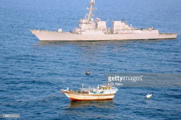 In this handout provided by the US Navy the guidedmissile destroyer USS Kidd responds to a distress call from the Iranian fishing vessel Al Molai off...