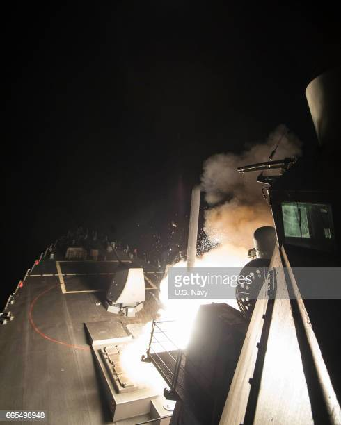 In this handout provided by the US Navy the guidedmissile destroyer USS Ross fires a Tomahawk land attack missile April 7 2017 in the Mediterranean...