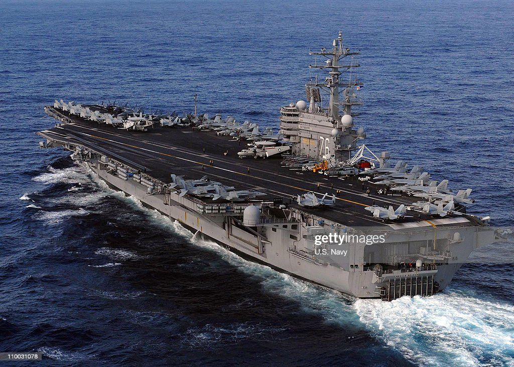 In this handout provided by the US Navy the Nimitzclass aircraft carrier USS Ronald Reagan is underway in the US 7th Fleet area of responsibility in...