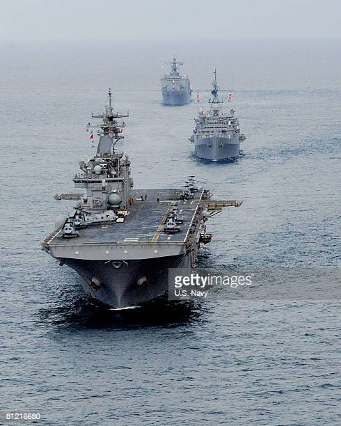 In this handout provided by the US Navy the USS Essex and the Essex Amphibious Ready Group steam in formation May 23 2008 in the Andaman Sea The...