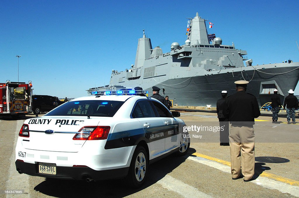 In this handout provided by the U.S. Navy,first responders from Arlington County, Va., welcome the amphibious transport dock ship Pre-Commissioning Unit (PCU) Arlington (LPD 24) on March 22, 2013 as it arrives pierside at Naval Station Norfolk, Virginia. Arlington was named for Arlington County, Va., and honors first responders and the 184 victims of the Sept. 11, 2001 attack on the Pentagon.