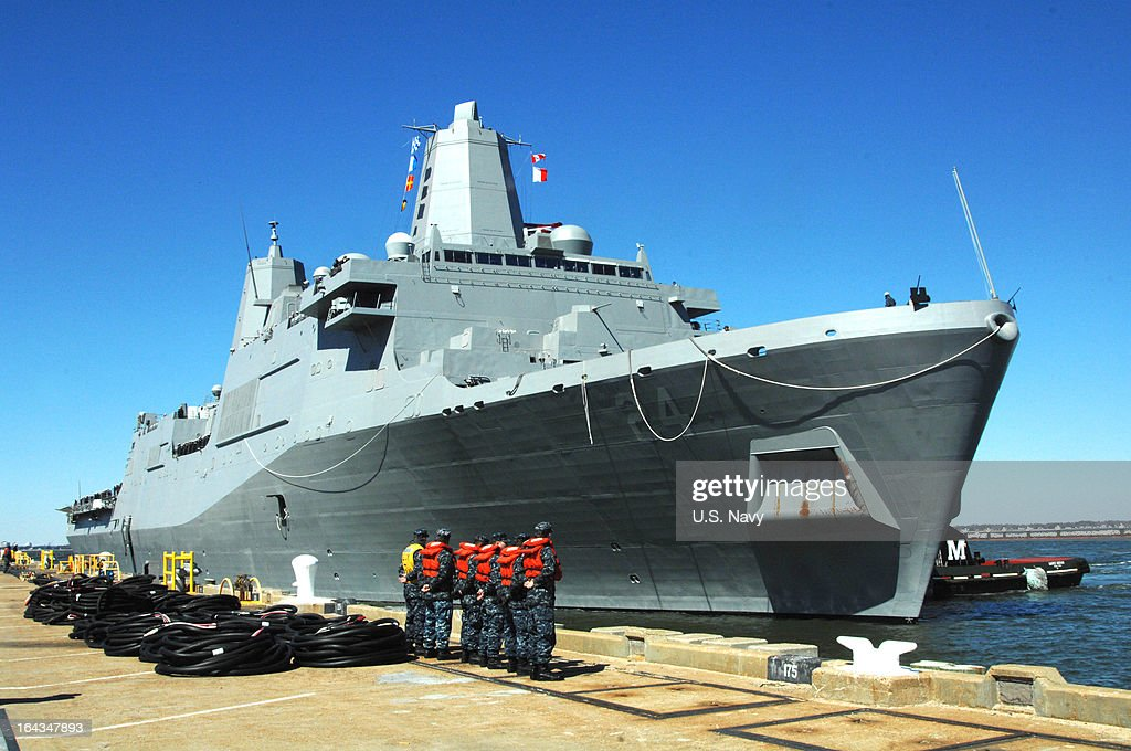 In this handout provided by the U.S. Navy,the amphibious transport dock ship Pre-Commissioning Unit (PCU) Arlington (LPD 24) is positioned at its berth on March 22, 2013 at its new homeport of Naval Station Norfolk,Virgina. Arlington was named for Arlington County, Va., and honors first responders and the 184 victims of the Sept. 11, 2001 attack on the Pentagon.