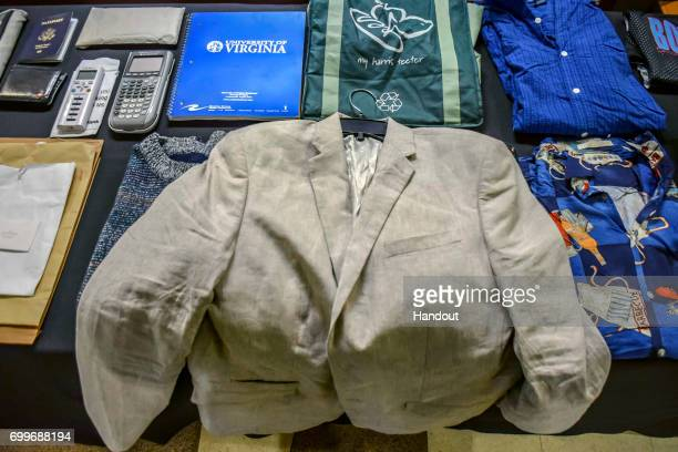 In this handout provided by The Warmbier Family a display of Otto's belongings he had with him while traveling abroad at the funeral service of Otto...