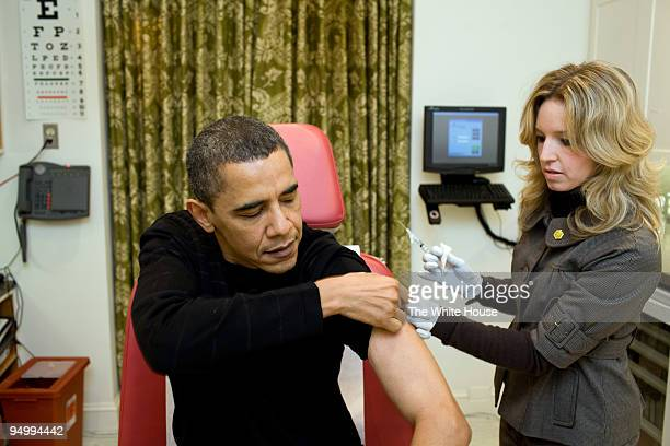 In this handout provided by the White House A White House nurse prepares to administer the H1N1 vaccine to President Barack Obama at the White House...