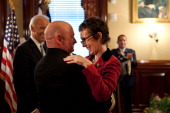 In this handout provided by the White House Captain Mark Kelly hugs his wife Congresswoman Gabrielle Giffords after receiving the Legion of Merit...