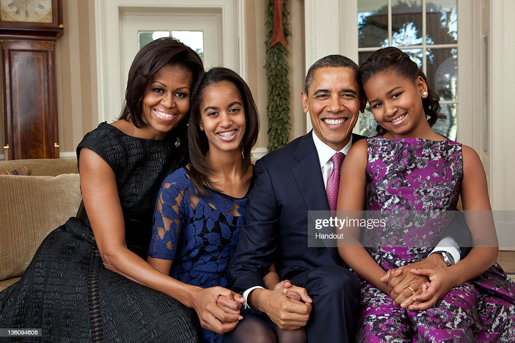 In this handout provided by the White House First Lady Michelle Obama Malia Obama US President Barack Obama and Sasha Obama sit for a family portrait...