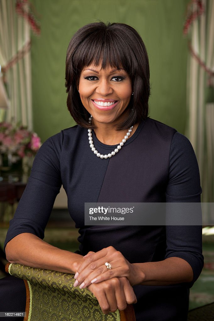 In this handout provided by the White House, first lady <a gi-track='captionPersonalityLinkClicked' href=/galleries/search?phrase=Michelle+Obama&family=editorial&specificpeople=2528864 ng-click='$event.stopPropagation()'>Michelle Obama</a> poses in the Green Room of the White House for her official photograph, made available to news outlets February 20, 2013 in Washington, DC. The portrait was released via the Flickr photo sharing website.