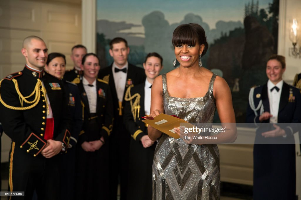 In this handout provided by The White House, First lady <a gi-track='captionPersonalityLinkClicked' href=/galleries/search?phrase=Michelle+Obama&family=editorial&specificpeople=2528864 ng-click='$event.stopPropagation()'>Michelle Obama</a> announces the Best Picture Oscar to Argo for the 85th Annual Academy Awards live from the Diplomatic Room of the White House February 24, 2012 in Washington, DC. Obama revealed the award via satellite for the live show being held in Los Angeles.