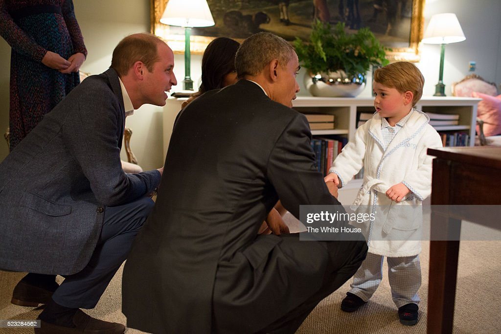 In this handout provided by The White House, President Barack Obama, Prince William, Duke of Cambridge and First Lady Michelle Obama talks with Prince George at Kensington Palace on April 22, 2016 in London, England. The President and his wife are currently on a brief visit to the UK where they attended lunch with HM Queen Elizabeth II at Windsor Castle and later dinner with Prince William and his wife Catherine, Duchess of Cambridge at Kensington Palace. Mr Obama visited 10 Downing Street this afternoon and held a joint press conference with British Prime Minister David Cameron where he stated his case for the UK to remain inside the European Union.