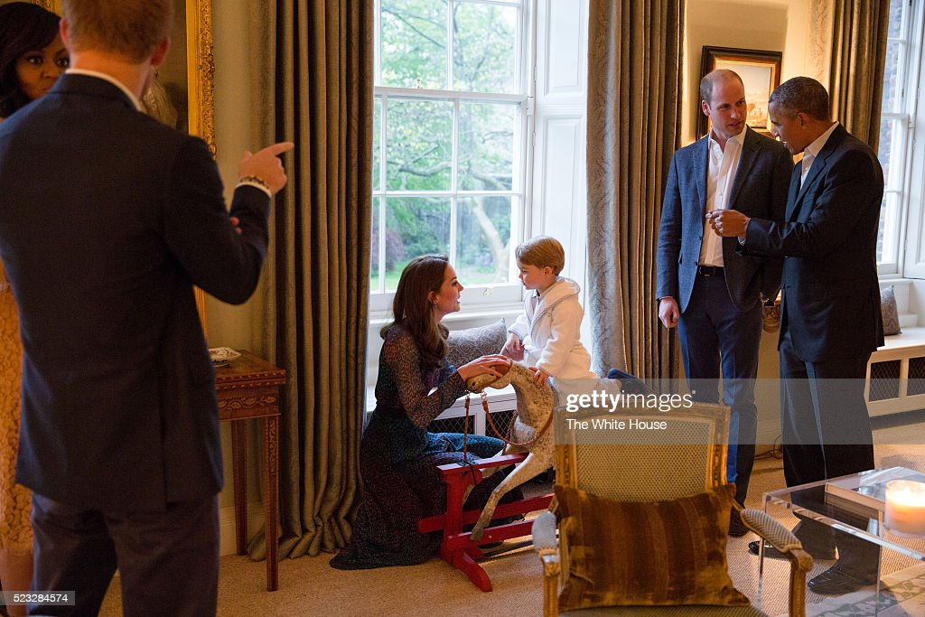 In this handout provided by The White House, President Barack Obama talks with the Prince William, Duke of Cambridge as Catherine, Duchess of Cambridge plays with Prince George as First Lady Michelle Obama talks with Prince Henry at Kensington Palace on April 22, 2016 in London, England. The President and his wife are currently on a brief visit to the UK where they attended lunch with HM Queen Elizabeth II at Windsor Castle and later dinner with Prince William and his wife Catherine, Duchess of Cambridge at Kensington Palace. Mr Obama visited 10 Downing Street this afternoon and held a joint press conference with British Prime Minister David Cameron where he stated his case for the UK to remain inside the European Union.