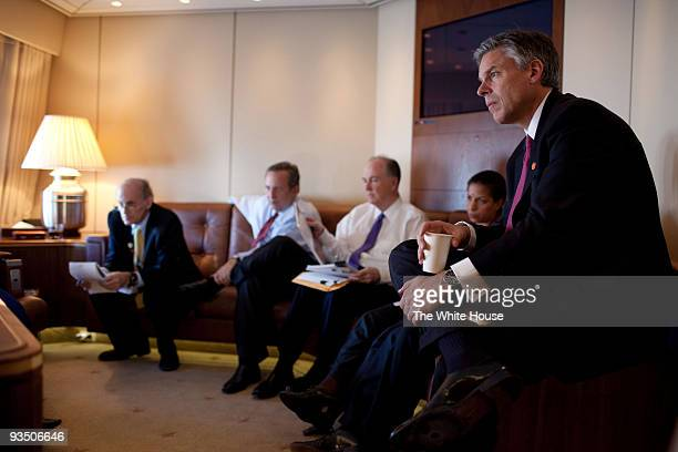 In this handout provided by the White House US Ambassador to China Jon Huntsman listens as President Barack Obama meets with advisors NSC Senior...