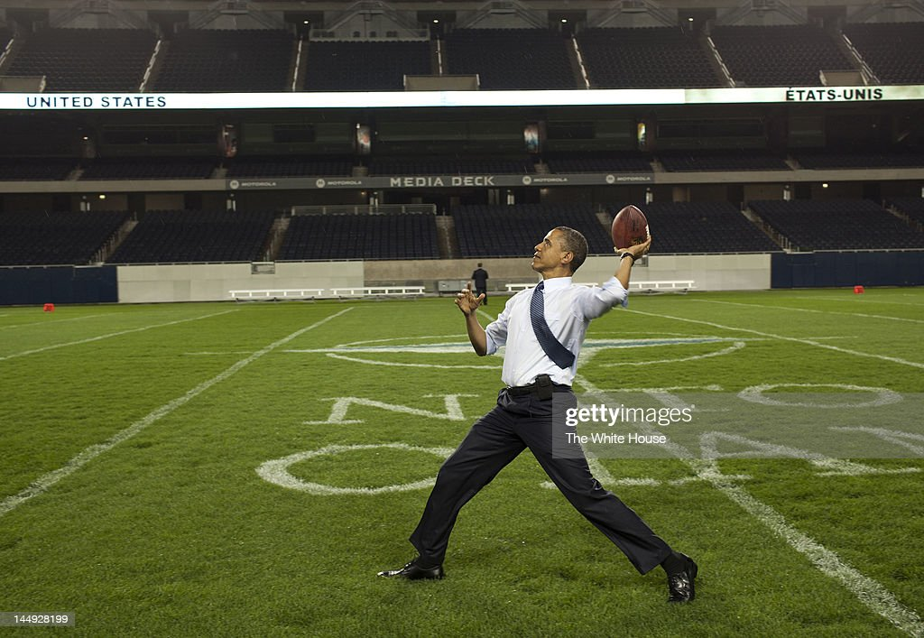 In this handout provided by the White House, U.S. President Barack Obama throws a football at Soldier Field following the NATO Summit working dinner on May 20, 2012 in Chicago, Illinois. As sixty heads of state converge for the two day summit that will address the situation in Afghanistan among other global defense issues, thousands of demonstrators have taken the streets to protest.