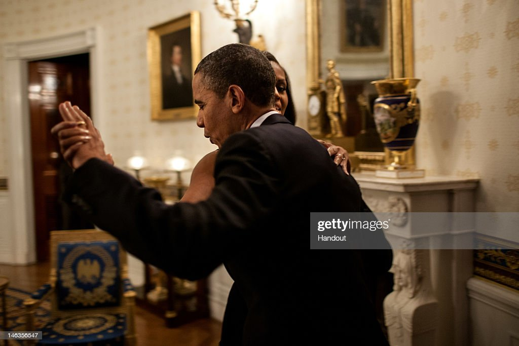 In this handout provided by the White House, U.S. President Barack Obama dances with First Lady Michelle Obama in the Blue Room of the White House prior to an 'In Performance at the White House' series concert honoring songwriters Burt Bacharach and Hal David, on May 9, 2012 in Washington, D.C. During the concert the President presented Bacharach and Eunice David, on behalf of her husband, with the Library of Congress Gershwin Prize for Popular Song.