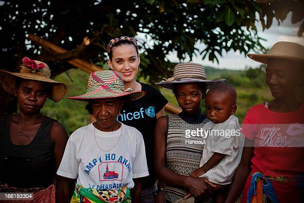 In this handout provided by UNICEF UNICEF supporter Katy Perry joins a group of women one of whom is holding a small child during a visit to a...