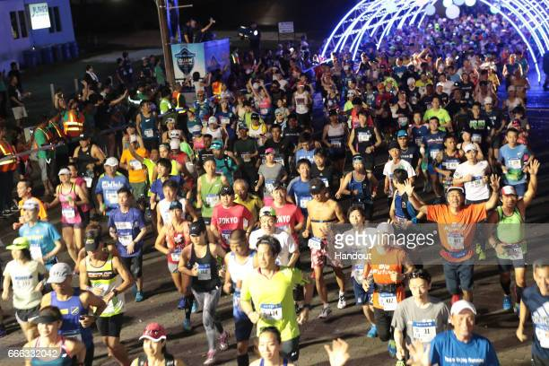 In this handout provided by United Airlines Guam Marathon competitors take part in the fifth annual United Airlines Guam Marathon 2017 on April 9...