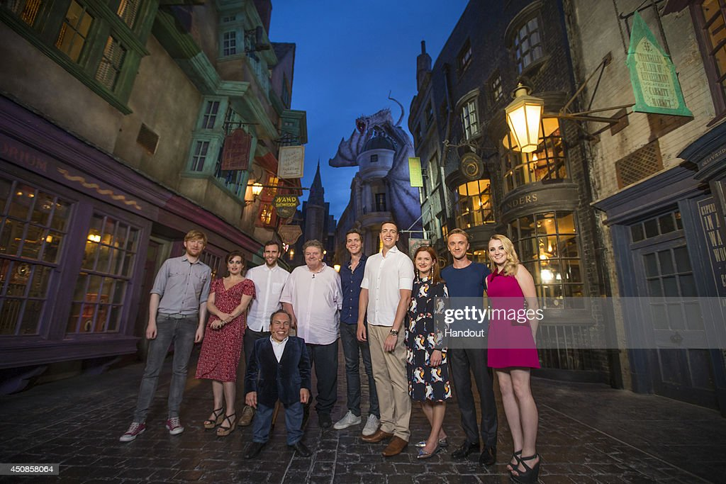In this handout provided by Universal Orlando Resort, Harry Potter film stars including <a gi-track='captionPersonalityLinkClicked' href=/galleries/search?phrase=Helena+Bonham+Carter&family=editorial&specificpeople=210567 ng-click='$event.stopPropagation()'>Helena Bonham Carter</a> (Bellatrix Lestrange), <a gi-track='captionPersonalityLinkClicked' href=/galleries/search?phrase=Robbie+Coltrane&family=editorial&specificpeople=644111 ng-click='$event.stopPropagation()'>Robbie Coltrane</a> (Hagrid) <a gi-track='captionPersonalityLinkClicked' href=/galleries/search?phrase=Tom+Felton&family=editorial&specificpeople=2166394 ng-click='$event.stopPropagation()'>Tom Felton</a> (Draco Malfoy), Matthew Lewis (Neville Longbottom) attended an exclusive preview of The Wizarding World of Harry Potter - Diagon Alley at Universal Orlando Resort on June 18, 2014 in Orlando, Florida.
