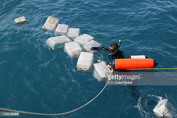 In this handout provided by US Coast Guard he crew of the Coast Guard Cutter Seneca interdicts a drug smuggling selfpropelled semisubmersible vessel...