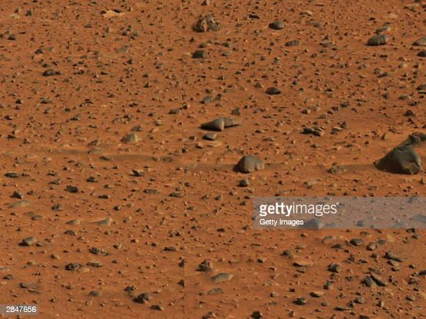 In this handout released by NASA streaks in the Martian soil caused by prevailing winds are seen in an image taken by the panoramic camera on the...