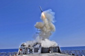In this handout released by the US Navy the US Navy guidedmissile destroyer USS Barry launches a Tomahawk cruise missile in support of Operation...