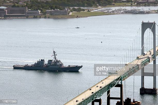 In this handout released by the US Navy the US Navy guidedmissile destroyer USS Mahan prepares to pass under the Pell Clairborne Bridge as the ship...