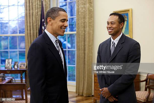 In this handout released today by the White House US President Barack Obama talks with professional golfer Tiger Woods in the Oval Office of the...