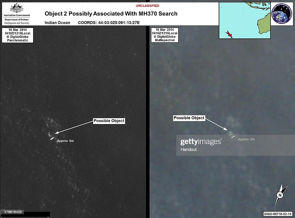 OCEAN - In this handout Satellite image made available by the AMSA (Australian Maritime Safety Authority) on March 20, 2014, objects that may be possible debris of the missing Malaysia Airlines Flight MH370 are shown in a revised area 185 km to the south east of the original search area. The imagery has been analysed by specialists in Australian GeoSpacial-Intelligence Organisation and is considered to provide a possible sighting of objects that has resulted in a refinement of the search area. Two objects possibly connected to the search for the passenger liner, missing for nearly two weeks after disappearing on a flight from Kuala Lumpur, Malaysia to Beijing, have been spotted in the southern Indian Ocean, according to published reports quoting Australian Prime Minister Tony Abbott.