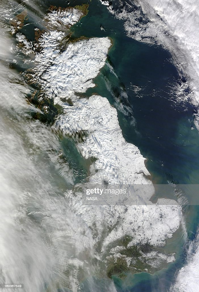 In this handout satellite image provided by NASA, Great Britain is seen blanketed in snow stretching from London to the northern tip of Scotland on January 26, 2013 from Space. The Moderate Resolution Imaging Spectroradiometer (MODIS) on NASA's Terra satellite captured this natural-color image. Only some coastal areas and the southwestern part of the island were free of snow when MODIS took this picture. Skies had mostly cleared by the time MODIS acquired the image, but some clouds lingered in the west, casting shadows onto the snowy surface below. //earthobservatory.nasa.gov/NaturalHazards/view.php?id=80291