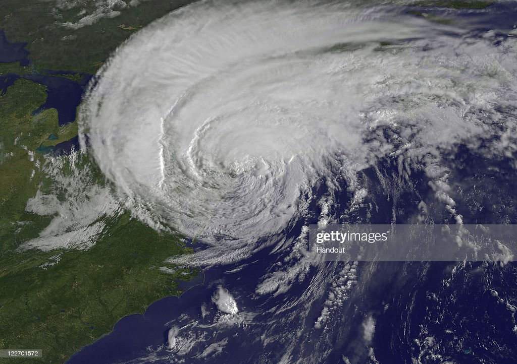 In this handout satellite image provided by NASA, Hurricane Irene, now downgraded to a tropical storm, is seen at 8:32 a.m. EDT, just 28 minutes before landfall in New York City August 28, 2011 in the Atlantic Ocean. While Hurricane Irene has now been downgraded to a tropical storm, it has knocked out power to more than 3 million people and is attributed to 15 deaths as it travels up the Eastern seaboard.