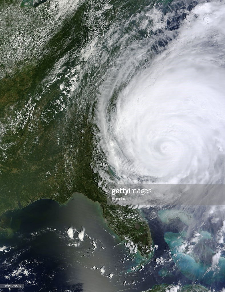 In this handout satellite image provided by NASA, Hurricane Irene churns of the cost of the Carolinas August 26, 2011 In the Atlantic Ocean. Irene, now a Category 2 storm, has started to lash the eastern coast of the U.S. with wind gust up to 125 miles per hour.
