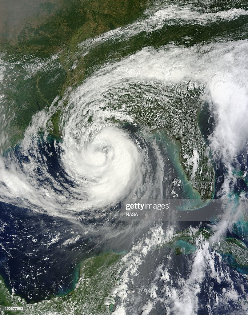In this handout satellite image provided by NASA, Hurricane Isaac moves in the Gulf of Mexico toward the Gulf Coast on August 28, 2012 in the Atlantic Ocean. According to reports, Isaac, a Category 1 hurricane, is expected to make landfall on Gulf Coast near New Orleans on August 29, the seven-year anniversary of Hurricane Katrina.
