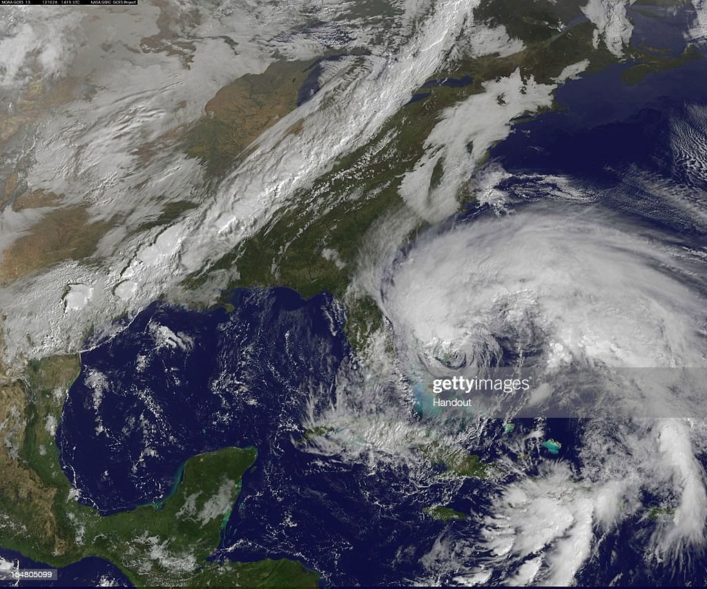In this handout satellite image provided by National Oceanic and Atmospheric Administration (NOAA), Hurricane Sandy's huge cloud extent of up to 2,000 miles churns over the Bahamas, as a line of clouds associated with a powerful cold front approaches the U.S. east coast on October 26, 2012 in the Atlantic Ocean. Sandy is expected to head up the East Coast this weekend and make a possible landfall anywhere from North Carolina to New England.