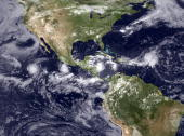 In this handout satellite image provided by the National Oceanic and Atmospheric Administration a very active Inter Tropical Convergence Zone shows...