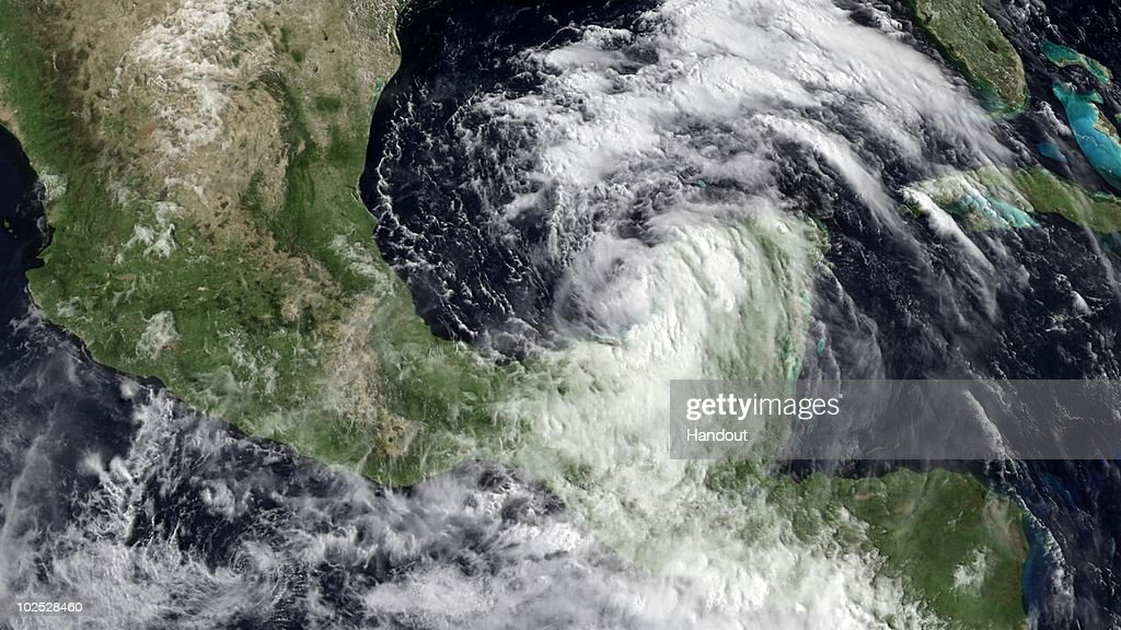 In this handout satellite image provided by the National Oceanic and Atmospheric Administration (NOAA), Tropical Storm Alex intensifies in strength in the southwestern Gulf of Mexico as it closes in to land near the Mexico-Texas border on June 28, 2010 as seen from space of the Gulf of Mexico. Tropical storm Alex, the first named storm of the Atlantic hurricane season this year, has cased BP and the Coast Guard to suspend cleanup efforts of the massive oil spill off the Louisiana coast due to high winds and rough waters. All oil skimming ships have been sent back to port due to unsafe conditions. The storm is expected to become a hurricane as it moves closer to shore steering clear of the oil spill but conditions might push oil farther inland.