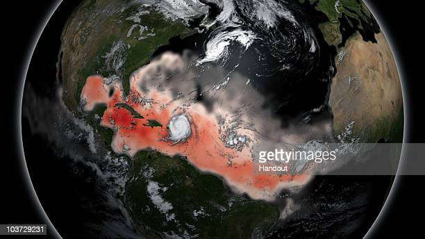 In this handout satellite image provided by the National Oceanic and Atmospheric Administration warm ocean temperatures intensify the strength of...