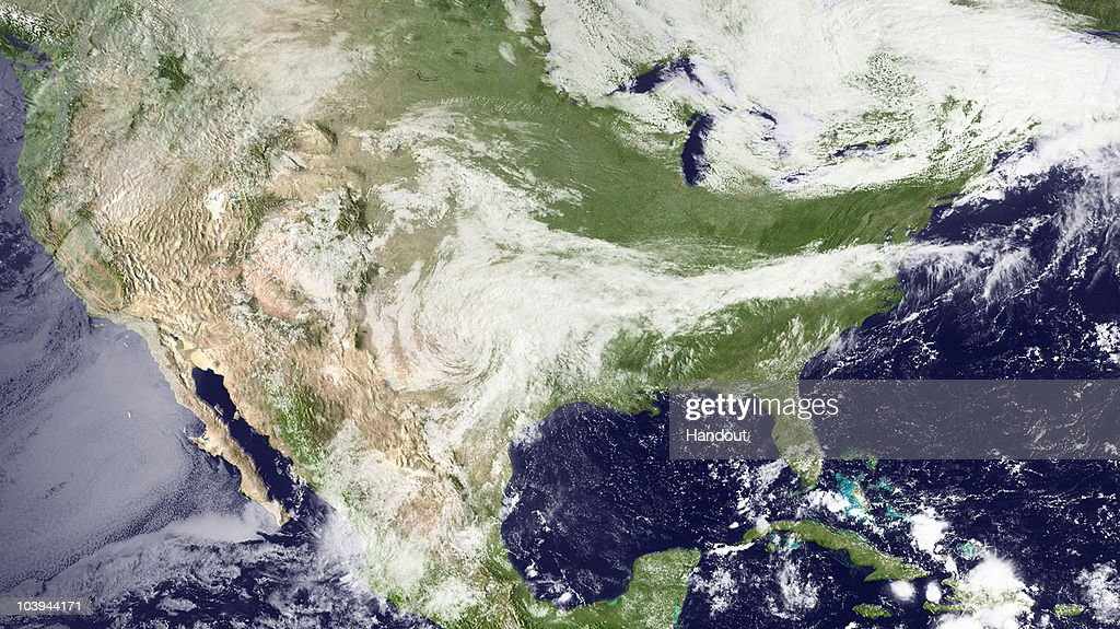 In this handout satellite image provided by the National Oceanic and Atmospheric Administration (NOAA), Tropical Depression Hermine churns west of Dallas, Texas September 9, 2010 as seen from space. Hermine was downgraded from a tropical storm to a depression when it made landfall in south Texas. It's currently moving north-northeast near 10 MPH, producing heavy rain and flooding.