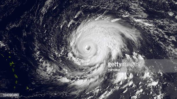 In this handout satellite image provided by the National Oceanic and Atmospheric Administration Hurricane Igor gets stronger as it turns...