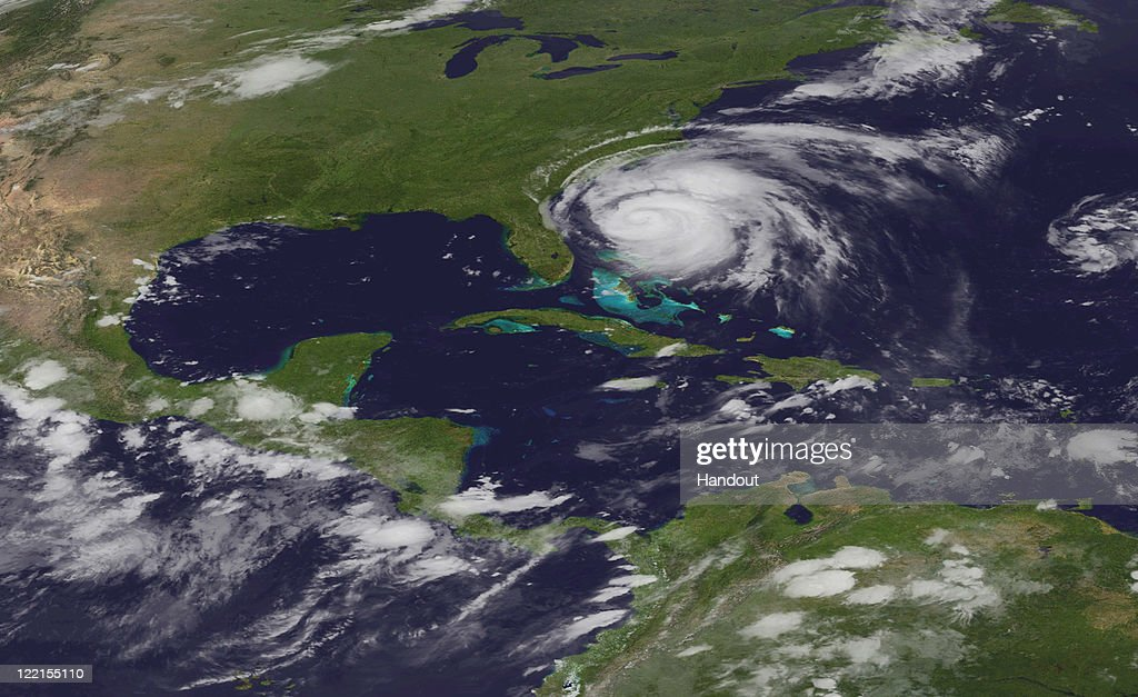 In this handout satellite image provided by the National Oceanic and Atmospheric Administration (NOAA), shows Hurricane Irene on August 25, 2011 in the Caribbean Sea. Irene, now a Category 3 storm with winds of 115 miles per hour, is projected to become Category 4 storm as it moves toward the eastern seaboard of the U.S. The eye has disappeared from this NOAA GOES-East satellite image, however, the storm is not weakening as it seems that Irene is going through an eyewall replacement cycle.