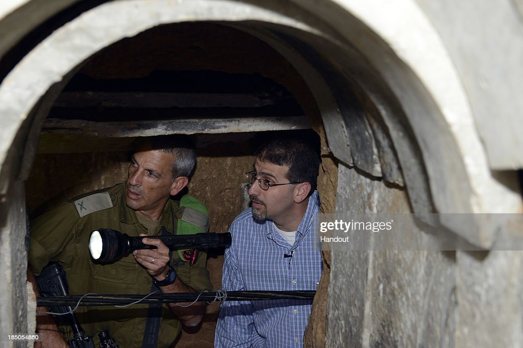 In this handout still from a video provided by the U.S. Embassy Tel Aviv, U.S. Ambassador to Israel Dan Shapiro (R) visits a recently-discovered tunnel leading from Gaza to Israel October 17, 2013 in Ein HaShlosha, Israel. Ambassador Shapiro demonstrated U.S. support for Israel's security and its right to defend itself. 'It is clear that this tunnel has only one purpose: to carry out terrorist attacks against Israeli civilians and IDF soldiers,' Shapiro said.
