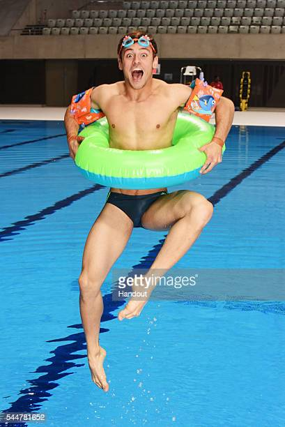 In this handout supplied by Disney Tom Daley films at the London Aquatic Centre for a new campaign from Disney Change4Life and the Amateur Swimming...