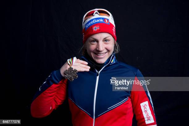 In this handout supplied by Nordic Focus Astrid Uhrenholdt Jacobsen of Norway poses with the bronze medal won in the Women's Cross Country 10km...