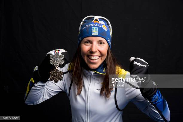 In this handout supplied by Nordic Focus Charlotte Kalla of Sweden poses with the silver medal won in the Women's Cross Country 10km during the FIS...