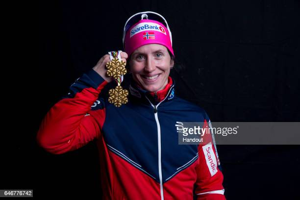 In this handout supplied by Nordic Focus Marit Bjoergen of Norway poses with the gold medal won in the Women's Cross Country 10km during the FIS...