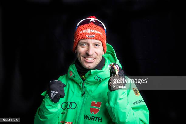 In this handout supplied by NordicFocus Bjoern Kircheisen of Germany poses with the Bronze medal after the medal ceremony for the Men's Nordic...